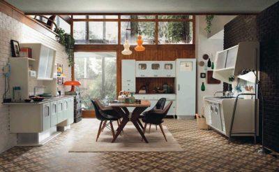 Cucina anni 50 mobili color celeste chiaro e tavola e sedie in legno scuro