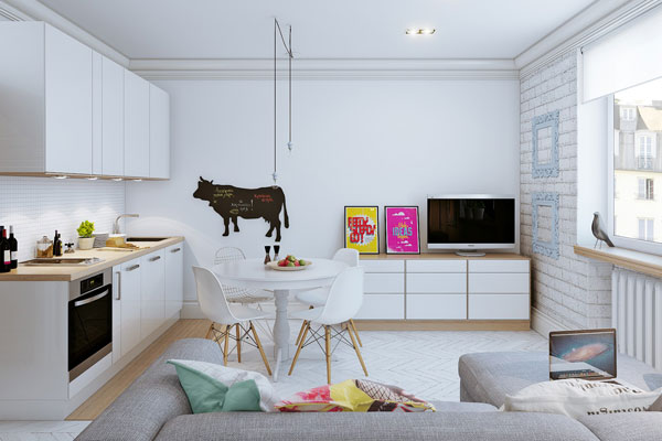 salone living con cucina a vista e parete di mattoncini bianchi