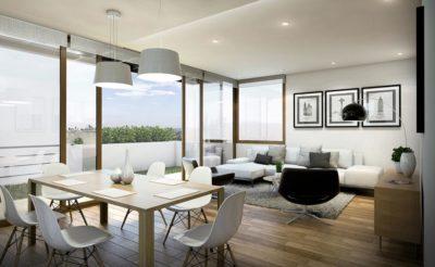 salone living con tavolo in legno e sedie in pvc, divano angolare bianco e poltrona di design