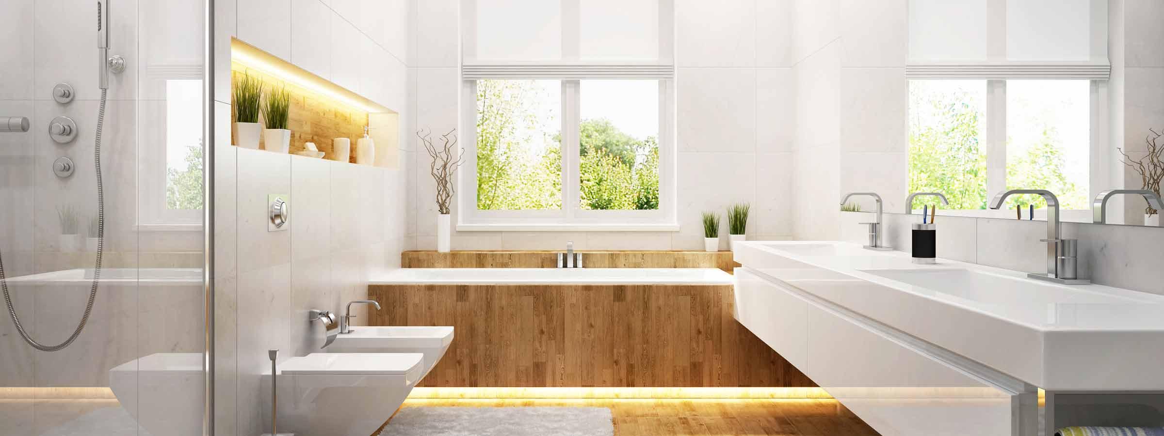 Bagno padronale con grande vasca ad incastro con finiture in legno, piattto doccia, sanitari filoparete e grande lavabo squadrato e specchio.