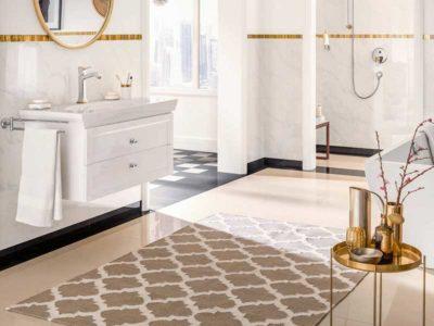 Vista di un bagno con un bel tappeto con fantasia a rombi al centro dell'ambiente