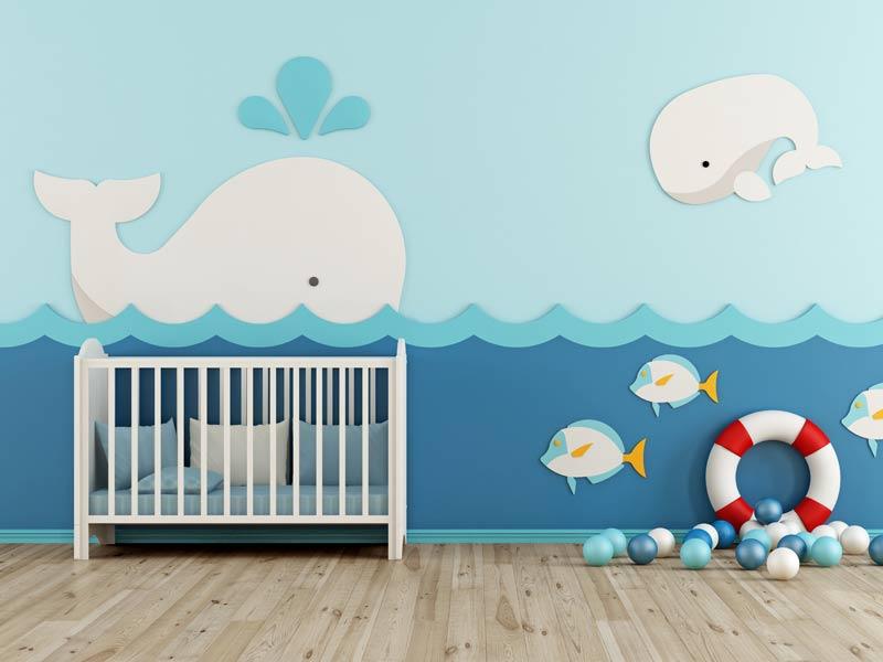 cameretta per bambini con culla a tema marino