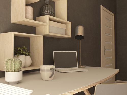 Vista di una scrivania all'interno di un ufficio casalingo in tinte chiare