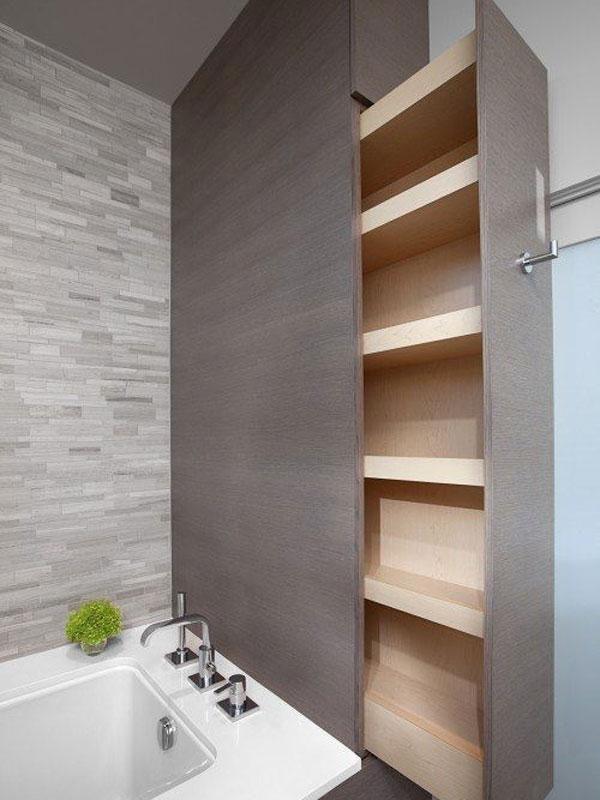 Vista laterale di una scarpiera da bagno a scomparsa dai colori legno scuro