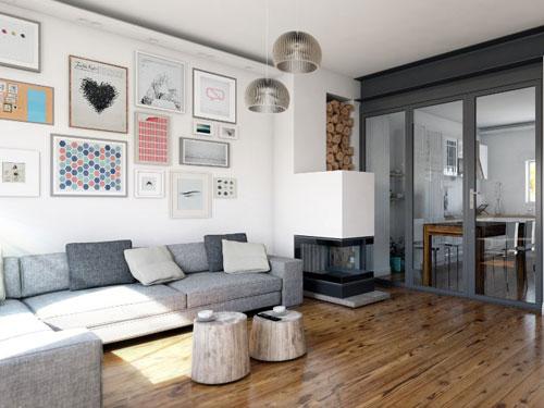 Salone arredato in stile moderno con ampio divano in tessuto e tavolino composto da due ceppi d'albero.